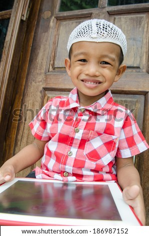muslim kid with tablet - stock photo
