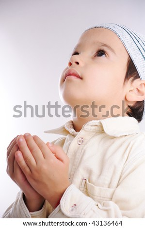 Muslim little cute kid with hat, isolated - stock photo