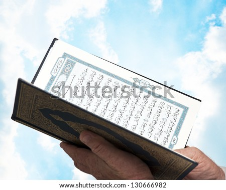 Muslim Male Hands with Quran - stock photo