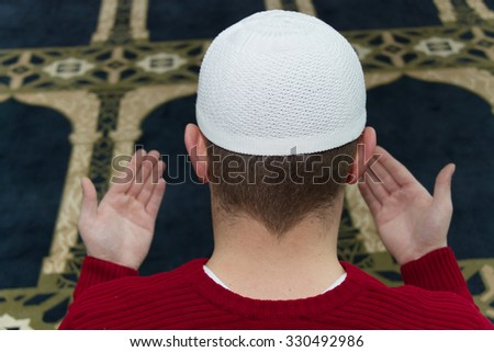 Muslim Man Is Praying In The Mosque - stock photo
