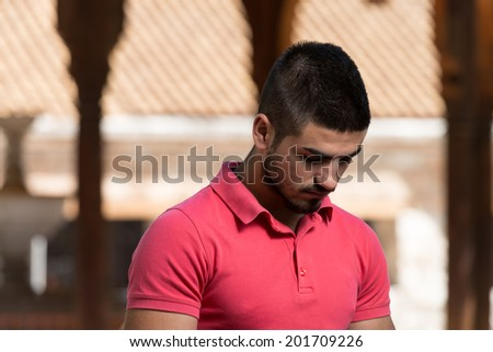 Muslim Man Is Praying In The Mosque Outdoors - stock photo
