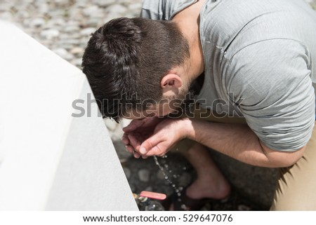 Muslim Man Preparing To Take Ablution In Mosque