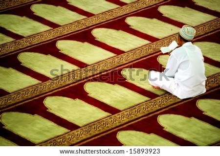 Muslim men praying at the mosque - stock photo