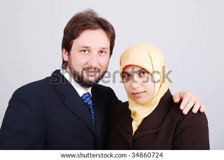 Muslim modern couple, wife and husband - stock photo