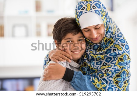Muslim modern mother with son at home