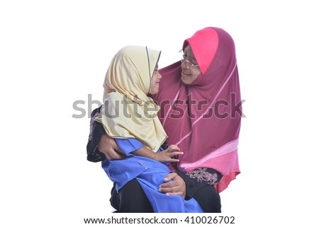 Muslim Mother and her daughter, isolated on white background - stock photo