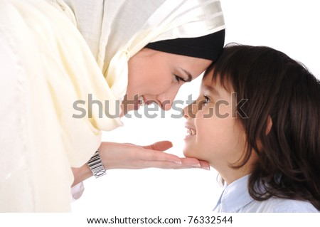 Muslim mother and son loving each other - stock photo