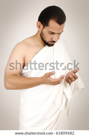 muslim pilgrim in white traditional clothes - stock photo