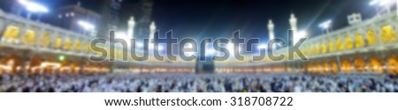 Muslim pilgrims circumambulate the Kaaba after dawn prayer at Masjidil Haram in Makkah, Saudi Arabia in panorama blurred background. for Islamic, hajj concept - stock photo