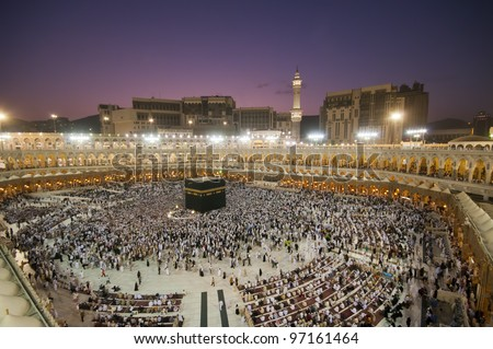 Muslim pilgrims circumambulate the Kaaba after dawn prayer at Masjidil Haram in Makkah, Saudi Arabia. Muslims all around the world face the Kaaba during prayer time. - stock photo