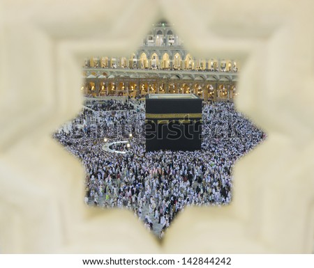 Muslim pilgrims circumambulate the Kaaba at Masjidil Haram in Makkah, Saudi Arabia. Muslims all around the world face the Kaaba during prayer time. - stock photo