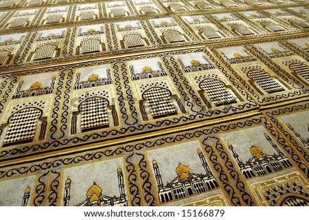 Muslim prayer mats in a mosque. - stock photo