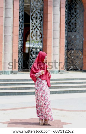 Muslim veiled woman from Indonesia, with an abstract background
