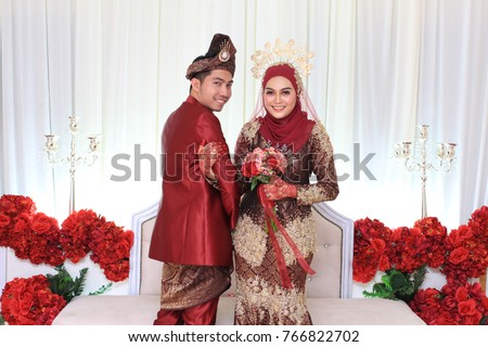 Muslim Wedding Couple Wearing Malay Traditional Clothing On Ceremony