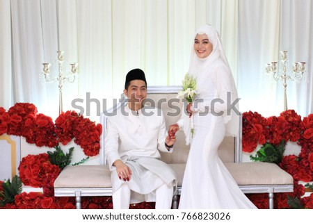 Muslim Wedding Couple Wearing White Dress On Malay Ceremony