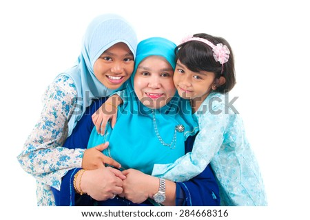 Muslim woman and her daughters - stock photo