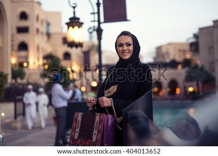 Muslim woman enjoying shopping time in the city. - stock photo