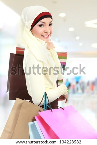 muslim woman shopping in the mall - stock photo