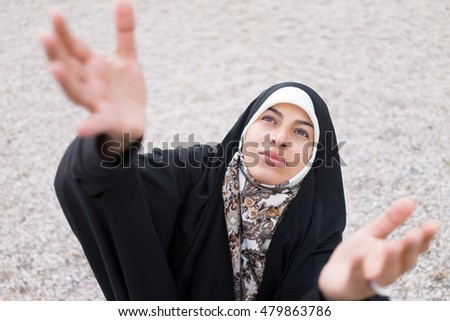 Muslim woman with hijab praying