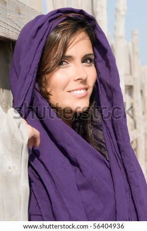 muslim woman with veil smiling - stock photo