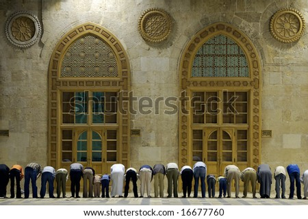 Muslims say prayers in old mosque in Damascus, Syria, second position #2 - stock photo