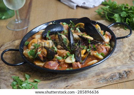 Mussel, pollock and bean stew - stock photo