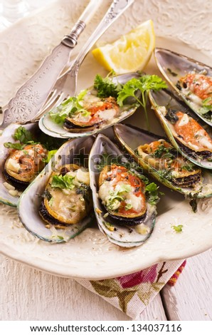 mussels baked with cheese and herbs - stock photo