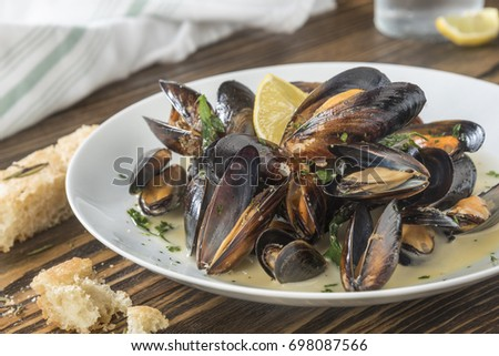 Mussels cooked with lemon and white wine Seafood plate specialty of both France and Belgium
