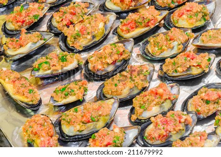 Mussels Gratin preparation in a drip pan, ready to be cooked in oven - stock photo