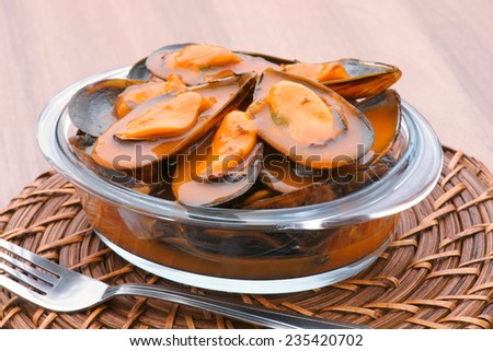 mussels in sauce pot - stock photo
