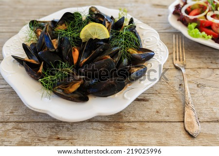 Mussels on a plate - stock photo