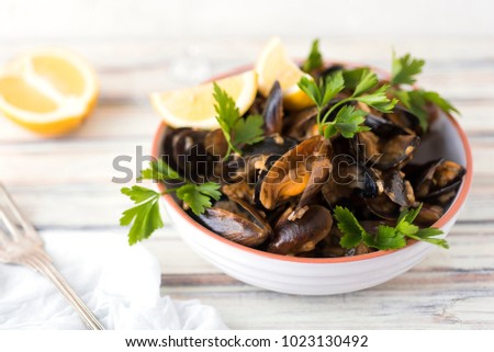 Mussels with rice and a cup of wine