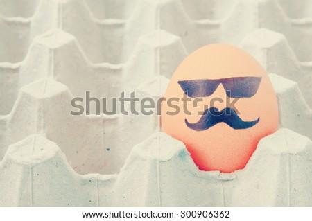 mustache face Eggs  arranged in carton - stock photo