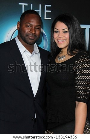"""Mustafa Harris and guest at """"The Host"""" World Premiere, Arclight, Hollywood, CA 03-19-13 - stock photo"""