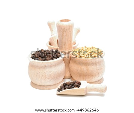 mustard and pepper seeds in wooden bowl - stock photo