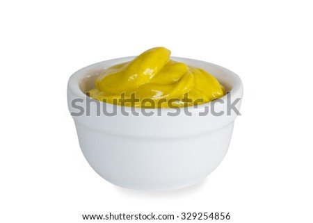 Mustard in a bowl isolated on white background - stock photo