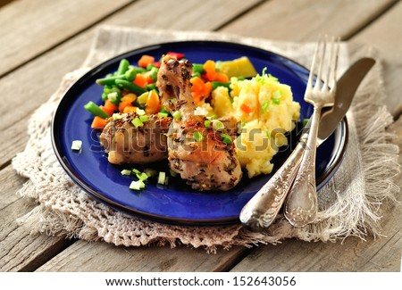 Mustard, lemon and rosemary roast chicken with mashed potatoes and vegetable mix - stock photo
