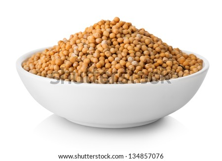 Mustard seeds in plate isolated on white background - stock photo