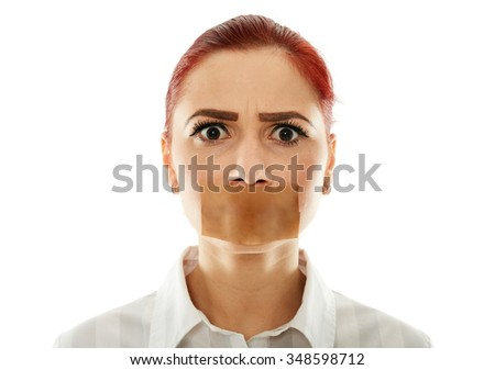 Muted businesswoman with adhesive tape over her mouth, closeup