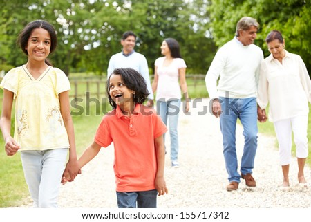 Muti-Generation Indian Family Walking In Countryside