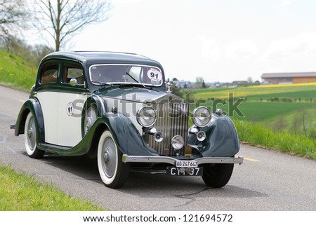 MUTSCHELLEN, SWITZERLAND-APRIL 29: Vintage pre war race car Rolls-Royce 25/30 from  1936 at Grand Prix in Mutschellen, SUI on April 29, 2012.  Invited were vintage sports cars and motorbikes. - stock photo
