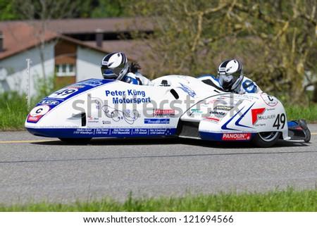 MUTSCHELLEN, SWITZERLAND-APRIL 29: Vintage race car LCR Suzuki F1 Sidecar from 1995 at Grand Prix in Mutschellen, SUI on April 29, 2012.  Invited were vintage sports cars and motorbikes. - stock photo