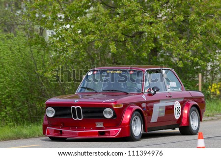 MUTSCHELLEN, SWITZERLAND-APRIL 29: Vintage race touring car BMW 2002 Tii Gruppe 2 from 1968 at Grand Prix in Mutschellen, SUI on April 29, 2012.  Invited were vintage sports cars and motorbikes. - stock photo