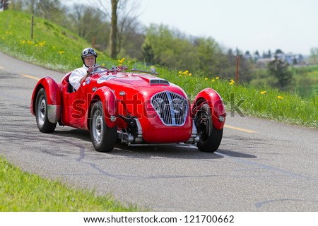 MUTSCHELLEN, SWITZERLAND-APRIL 29: Vintage race touring car Healey Silverstone Typ E from 1950 at Grand Prix in Mutschellen, SUI on April 29, 2012.  Invited were vintage sports cars and motorbikes.