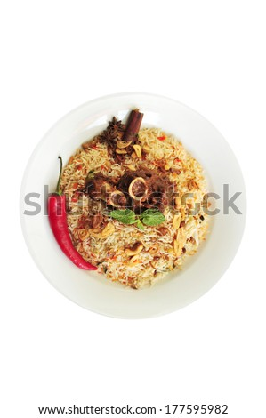 Mutton Byriani - Lamb and fragrance rice cooked with spices on white background - selective focusing - stock photo
