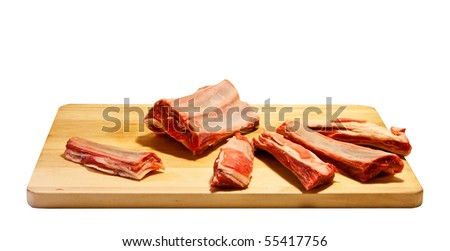 Mutton ribs on chopping board - stock photo