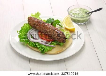 mutton seekh kabab kebab sandwich with mint chutney - stock photo