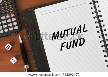 Mutual Fund word on a notebook - Finance Conceptual - stock photo