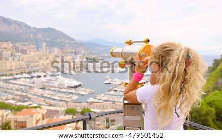 My daughter watches through binoculars Monaco