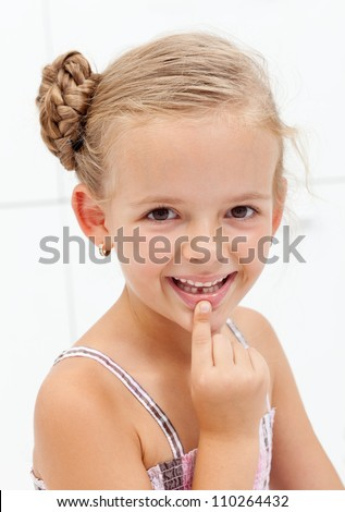 My first encounter with the tooth fairy - young girl showing missing teeth - stock photo